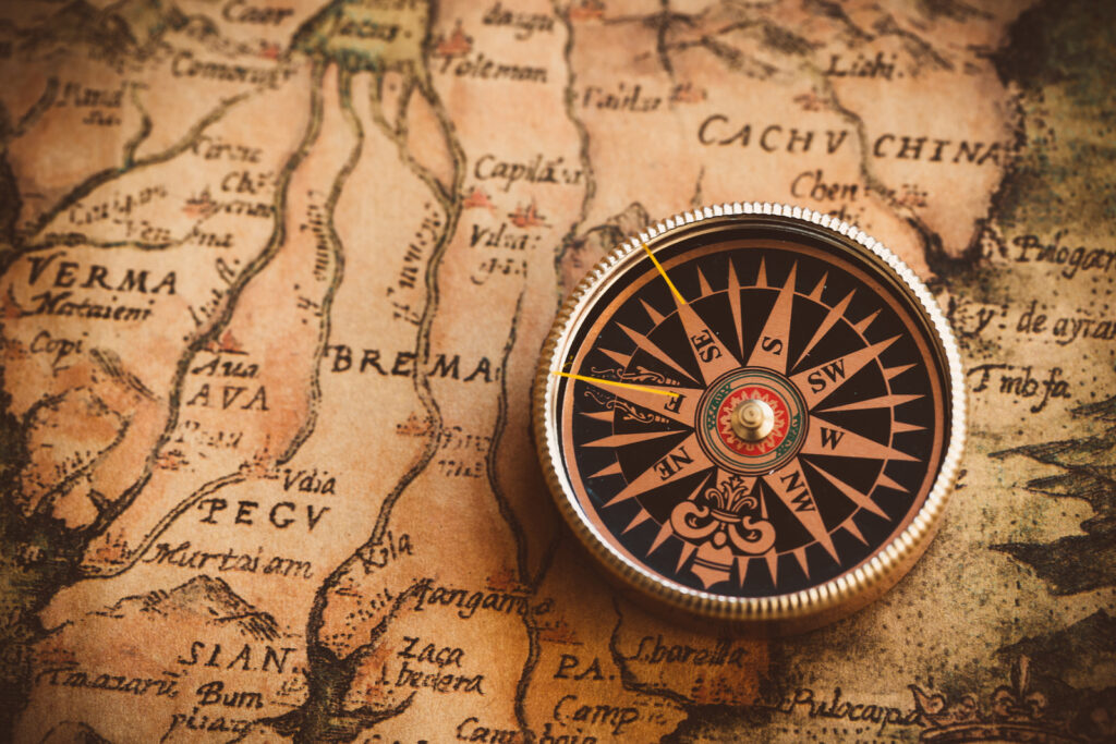 compass with antique map